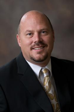 Spencer Atkins : Director
